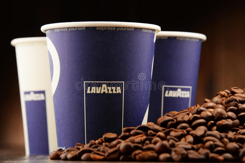Composition with cup of Lavazza coffee and beans. POZNAN, POLAND - APRIL 28, 2016: Lavazza is an Italian manufacturer of coffee products It was founded in Turin