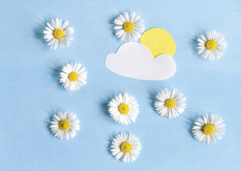 Composition of daisies and paper applications. Of clouds and sun stock photography