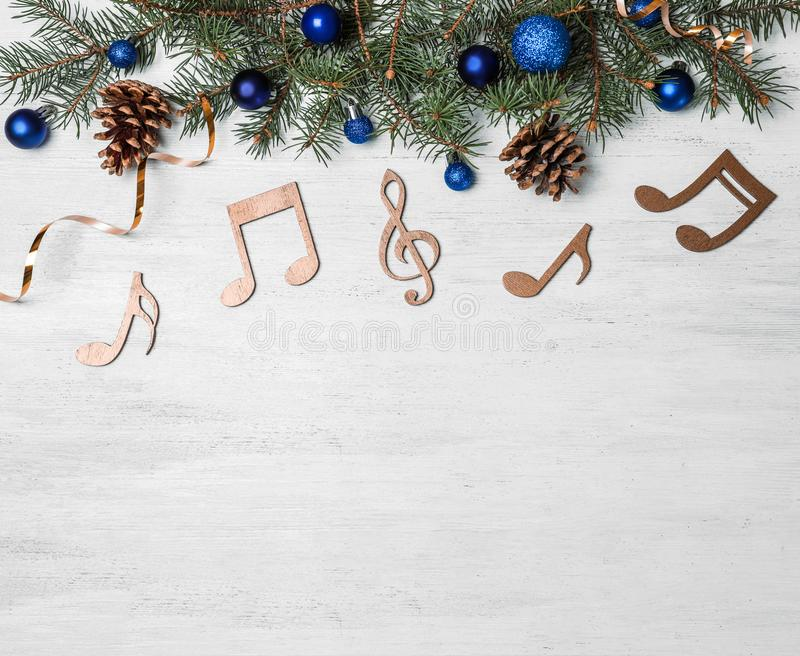 Composition with decorative music notes and space for text on wooden background stock image
