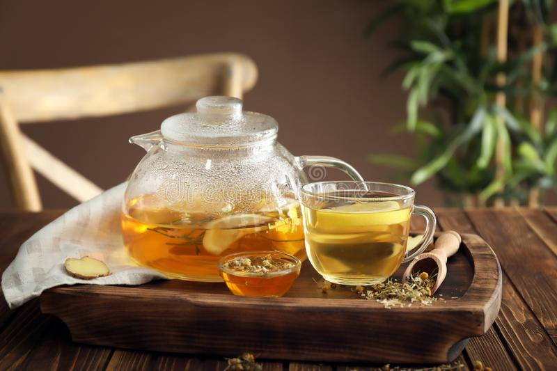 Composition with delicious camomile tea and honey on wooden table royalty free stock photo