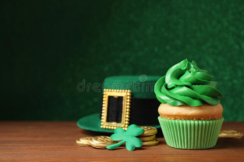 Composition with delicious decorated cupcake on table. St. Patrick`s Day celebration stock images