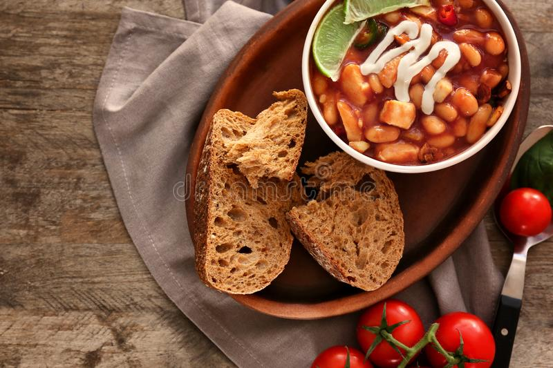 Composition with delicious turkey chili in bowl. On wooden table stock image