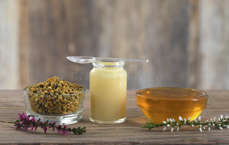 Composition with dietary supplement - organic honey bee product. Vitamins and nutritional supplements-organic honey bee products stock image