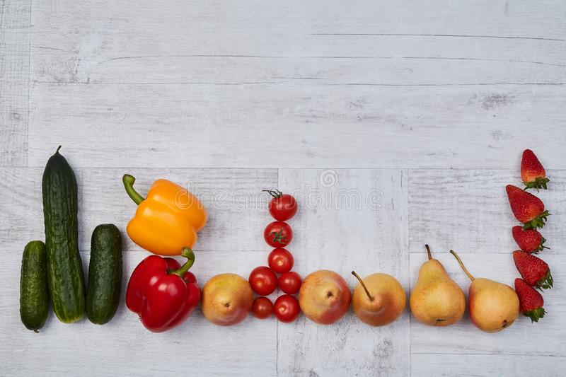 Composition of different ripe colorful fruits and vegetables. Colorful fruit and vegetables pattern or background.  royalty free stock photography