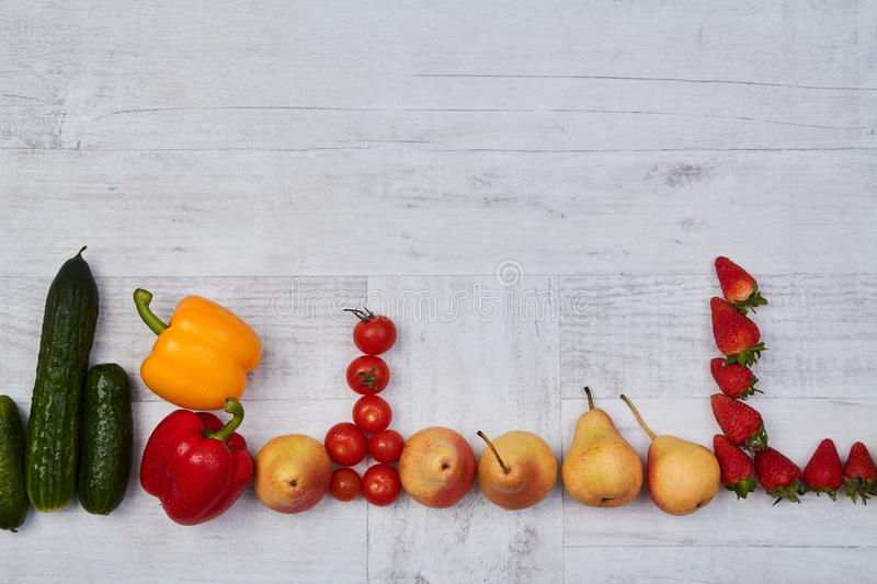 Composition of different ripe colorful fruits and vegetables. Colorful fruit and vegetables pattern or background.  stock photos