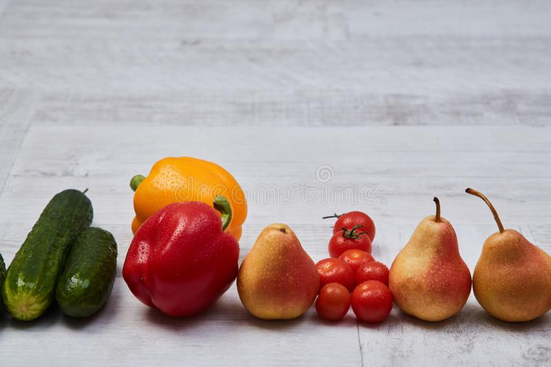 Composition of different ripe colorful fruits and vegetables. Colorful fruit and vegetables pattern or background. royalty free stock image