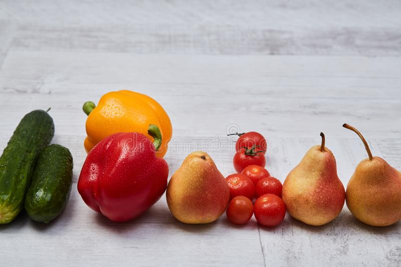 Composition of different ripe colorful fruits and vegetables. Colorful fruit and vegetables pattern or background.  royalty free stock photo