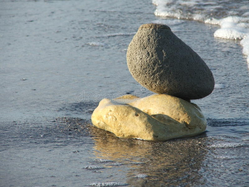 Composition with different stones and sea royalty free stock image