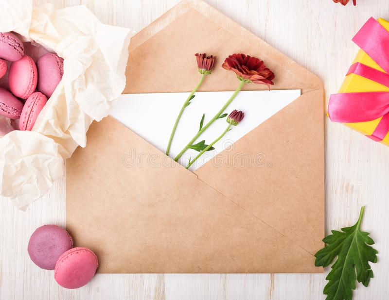 Composition with envelope, macaroons and flowers. royalty free stock photo