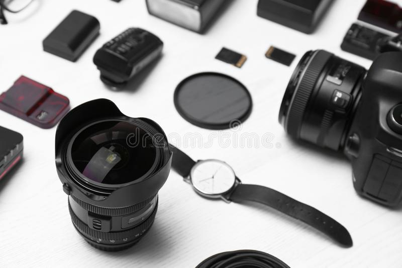 Composition with equipment for professional photographer. On wooden background stock images