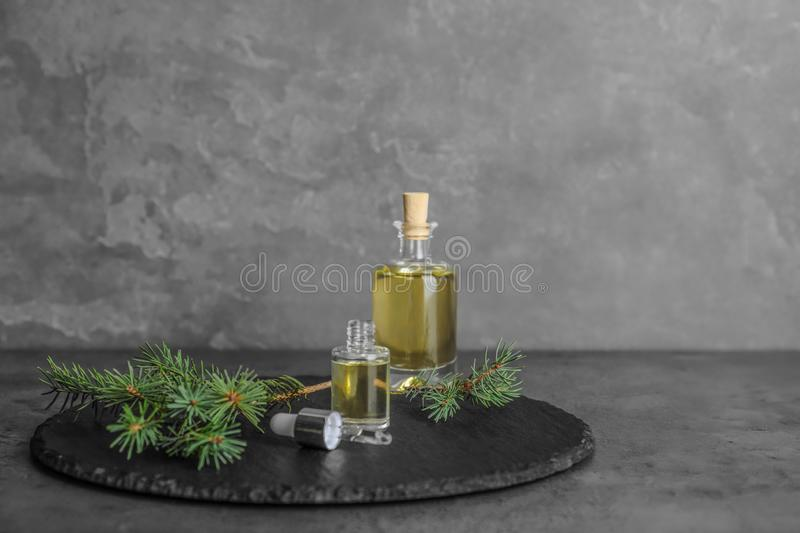 Composition with essential oil in glass bottles on table royalty free stock photography