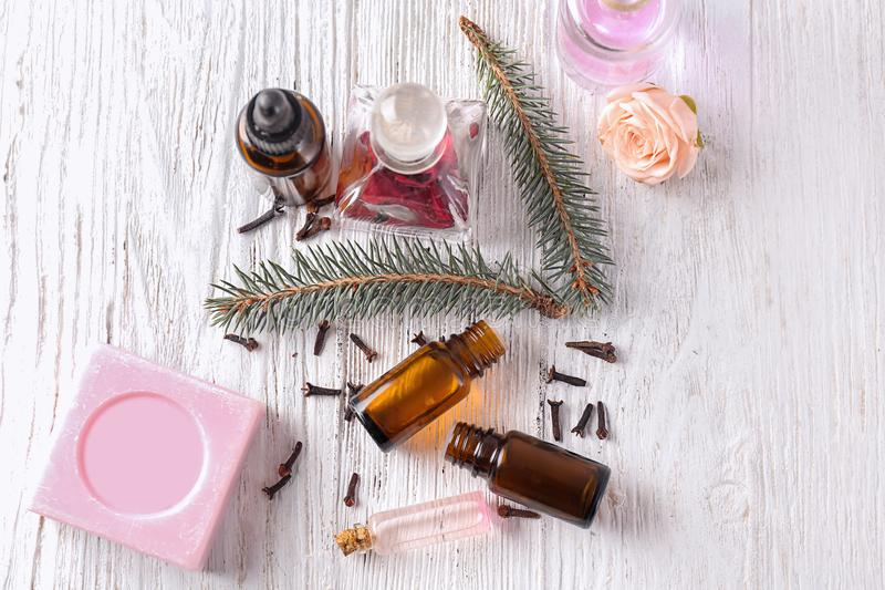 Composition with essential oils and soap on wooden table royalty free stock photos