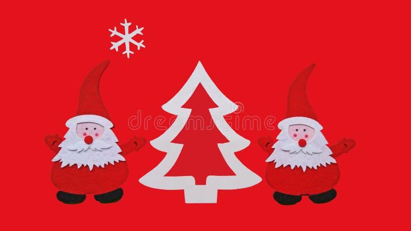 Composition faite main en Noël Dessin de l'arbre de Santa Claus et de nouvelle année fait de morceaux collés de feutre et de cont photographie stock libre de droits