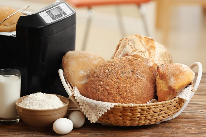 Composition with fresh loaves, bread machine royalty free stock photos