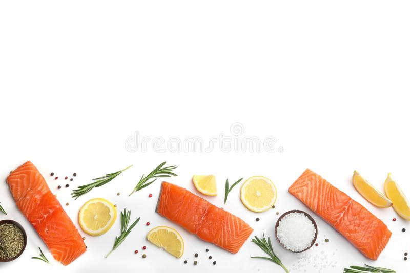 Composition with fresh salmon fillets on white background, top view. Composition with fresh raw salmon fillets on white background, top view royalty free stock photos