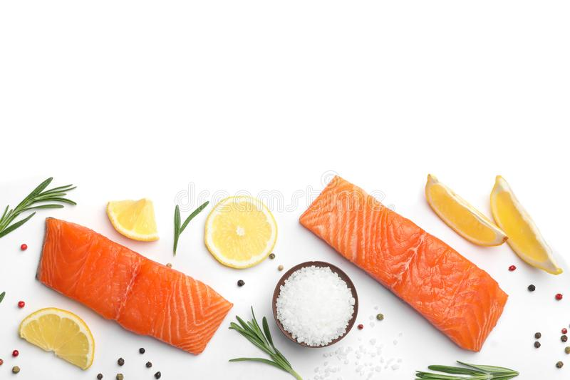 Composition with fresh raw salmon fillets on white background. Top view royalty free stock photography