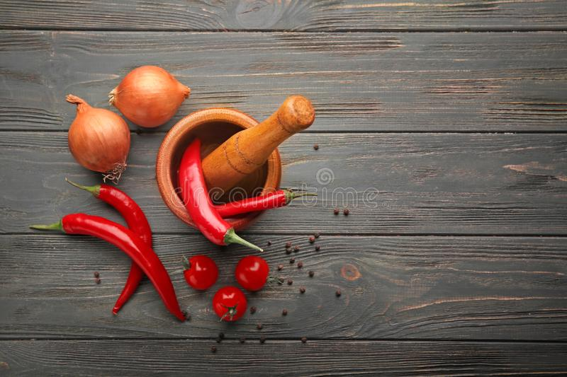 Composition with fresh spices and vegetables on wooden background royalty free stock photography