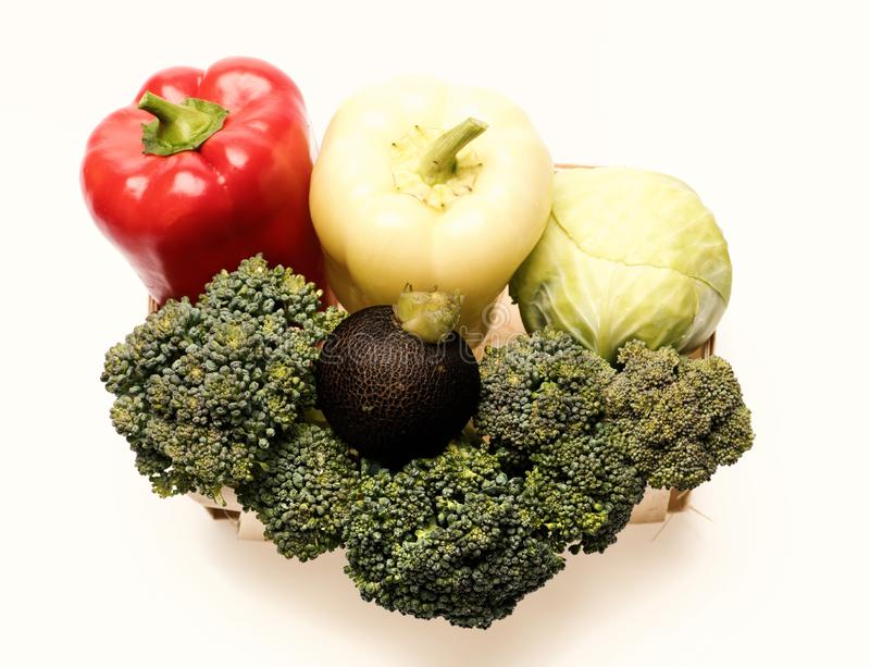Composition of fresh vegetables in eco basket. Broccoli, cabbage, peppers royalty free stock photo