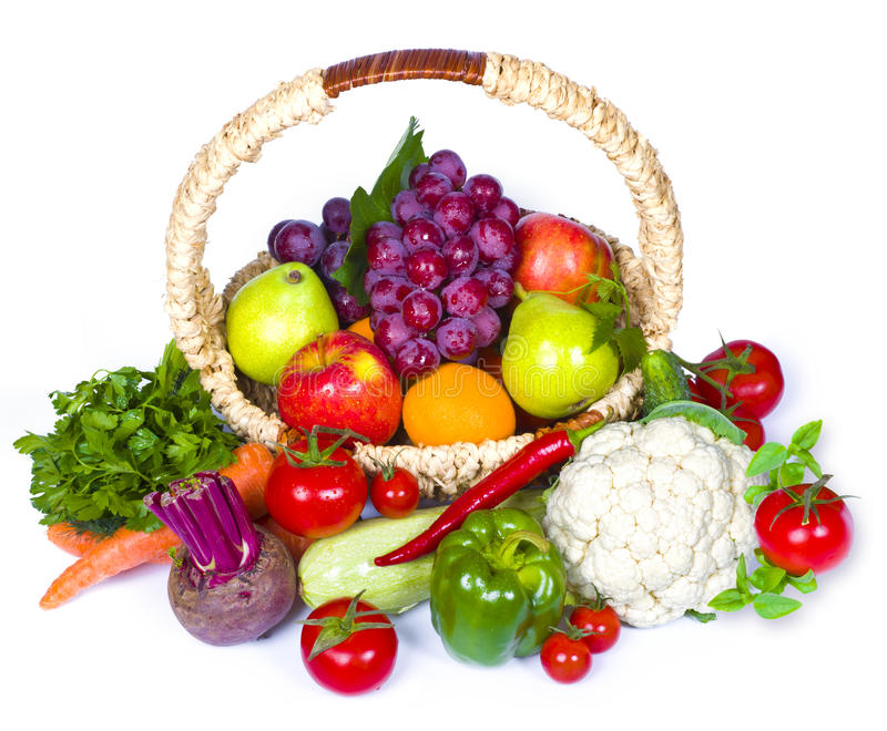 Composition of fruits and vegetables in wicker basket royalty free stock photography