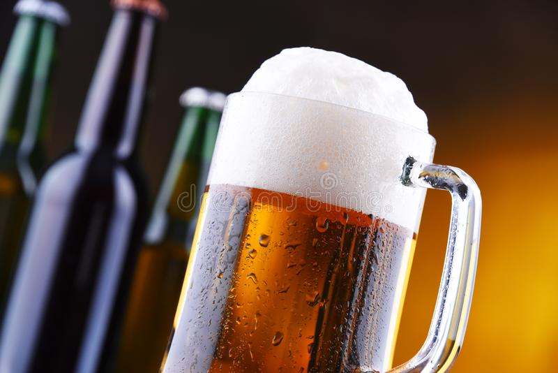Composition with glass and bottles of beer.  stock images
