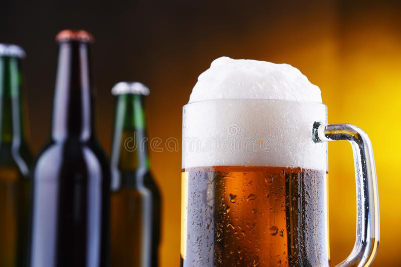 Composition with glass and bottles of beer.  royalty free stock photo