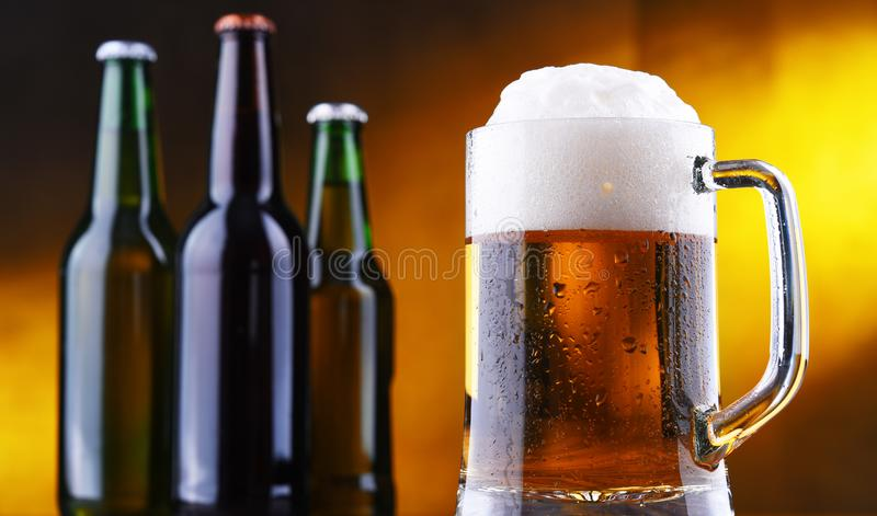 Composition with glass and bottles of beer.  stock photos