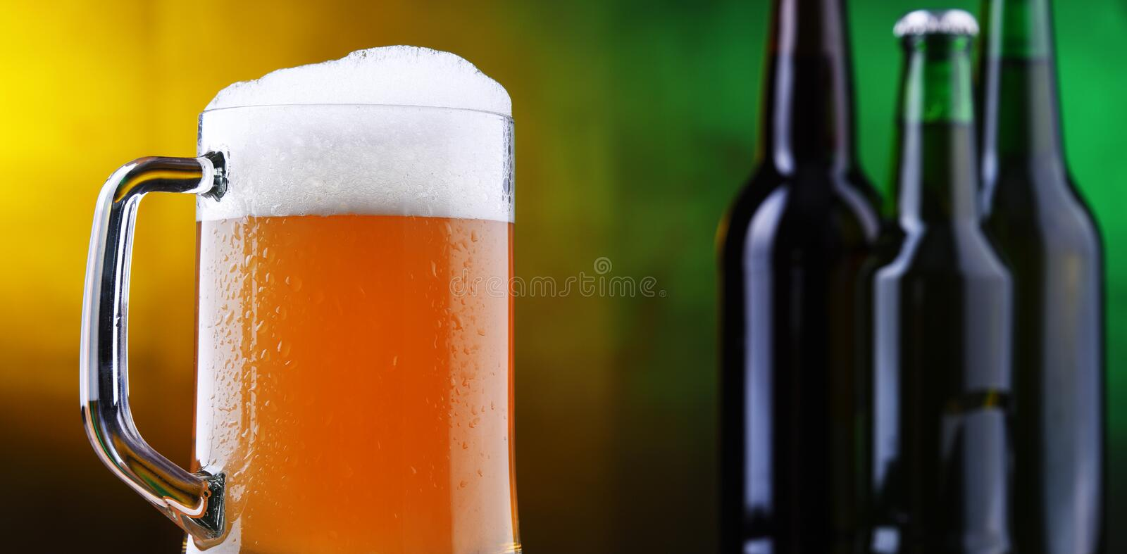 Composition with glass and bottles of beer.  royalty free stock image