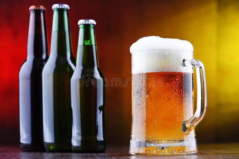 Composition with glass and bottles of beer.  royalty free stock images