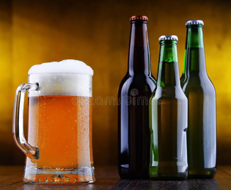 Composition with glass and bottles of beer.  stock photo