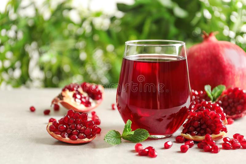 Composition with glass of fresh pomegranate juice on table royalty free stock photos