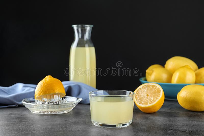 Composition with glass of freshly squeezed lemon juice royalty free stock photography