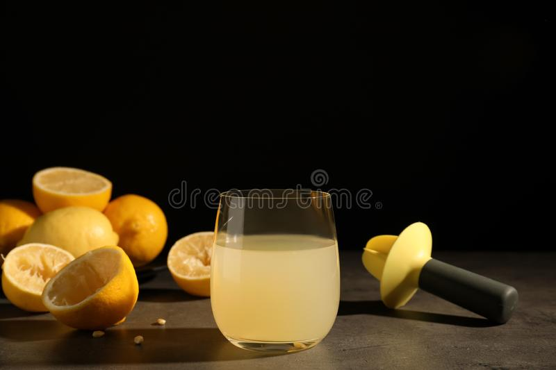Composition with glass of freshly squeezed lemon juice stock photos