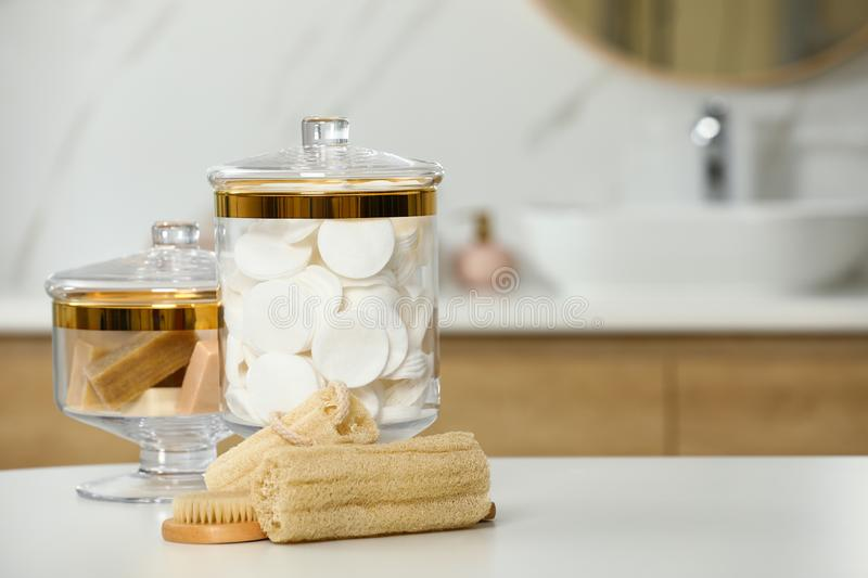Composition of glass jar with cotton pads in bathroom. Space for text. Composition of glass jar with cotton pads on table in bathroom. Space for text royalty free stock image