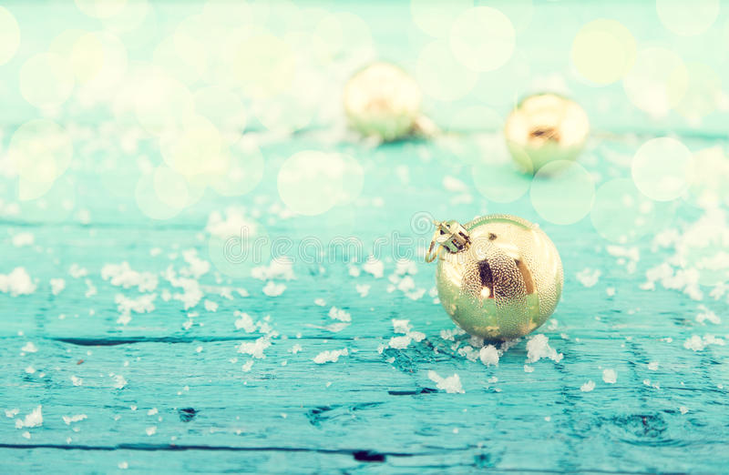 Composition with golden Christmas balls on rustic turquoise wood stock image
