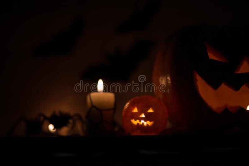 Composition for Halloween.sinister pumpkin on a dark background stock photos
