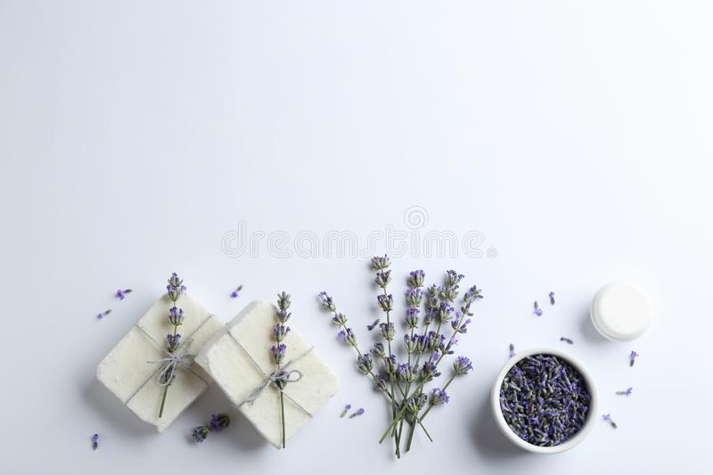 Composition with hand made soap bars and lavender flowers on white background royalty free stock image