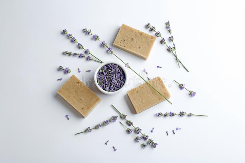 Composition with hand made soap bars and lavender flowers on white background royalty free stock photo