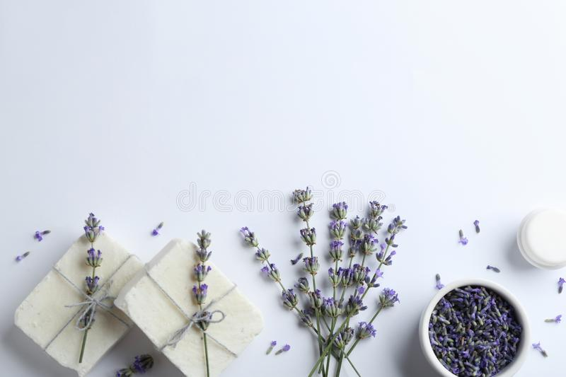 Composition with hand made soap bars and lavender flowers on white background. Top view stock images