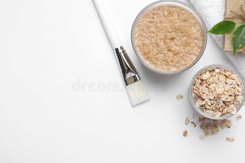Composition of handmade face mask and  on white background, top view. Composition of handmade face mask and ingredients on white background, top view royalty free stock photography