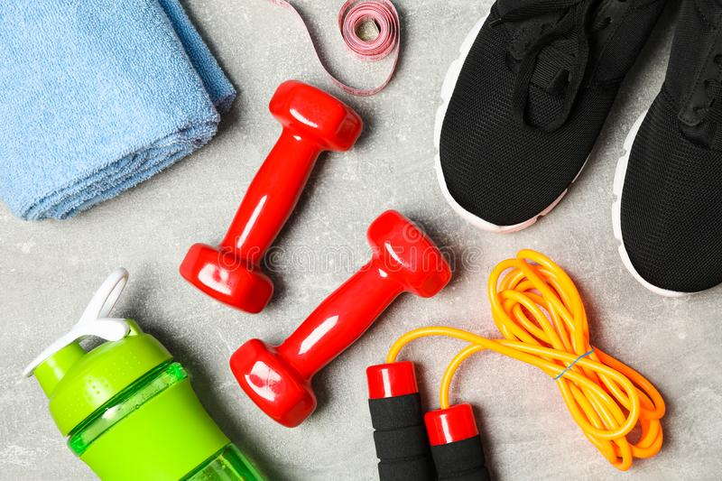 Composition with healthy lifestyle accessories. On grey background stock photos