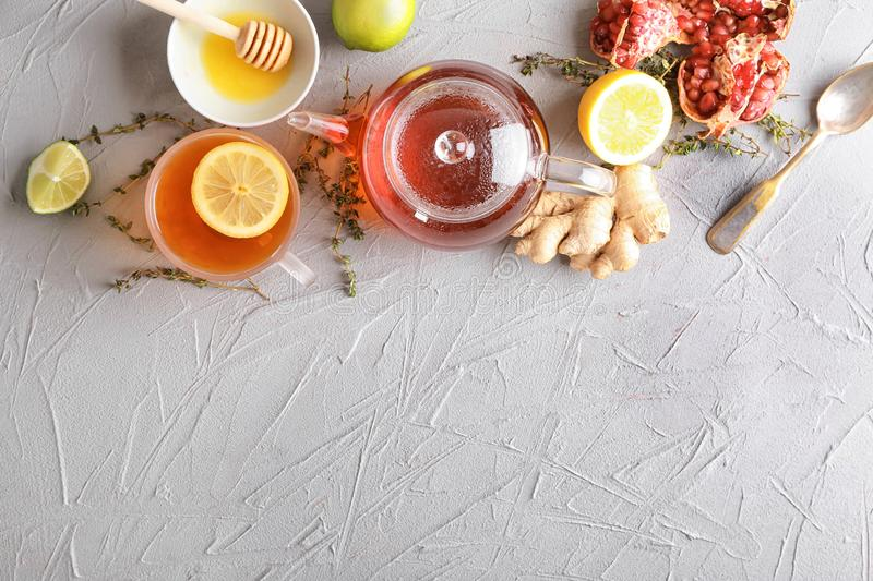 Composition with hot aromatic tea, lemon and ginger on table royalty free stock images