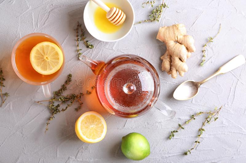 Composition with hot aromatic tea, lemon and ginger on table royalty free stock photos
