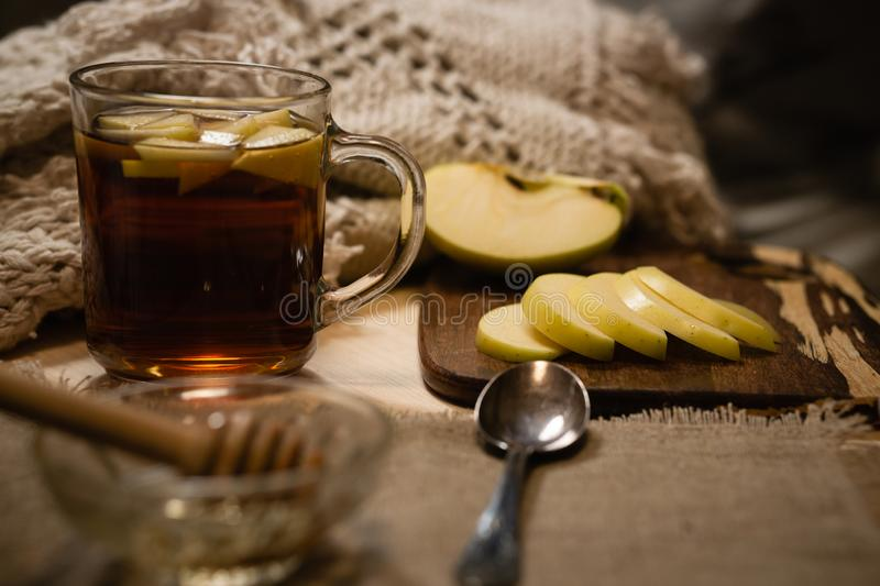 Composition with hot drink and sweet sliced fruits for cold autumn or winter days. stock photos