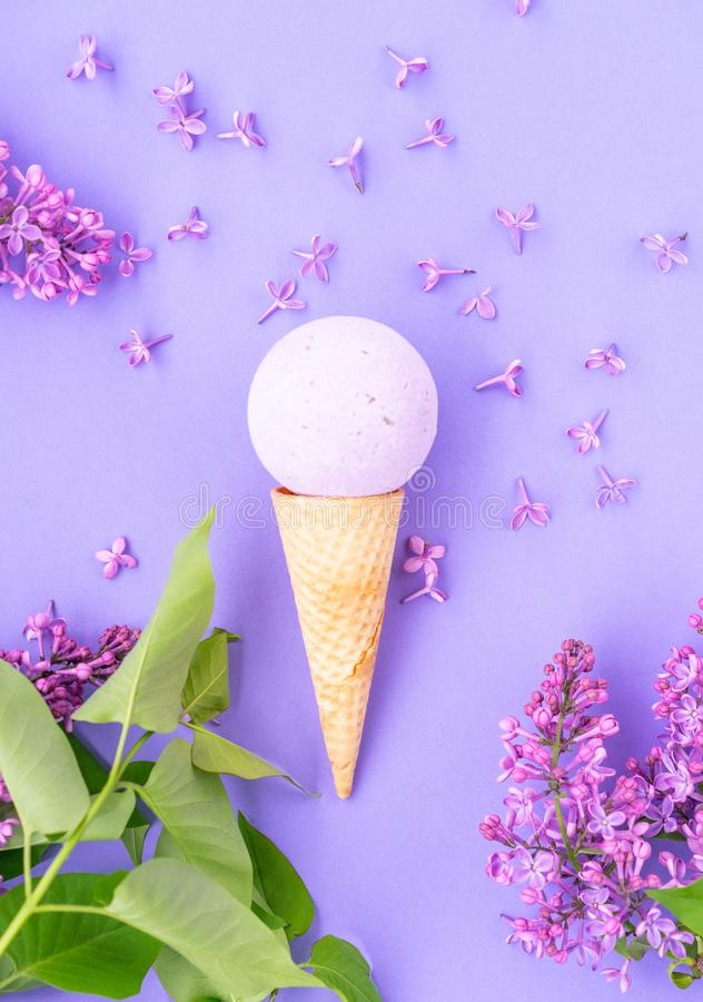 Composition of ice cream cone with bath ball on a violet background. Bathroom cosmetic accessories stock photography