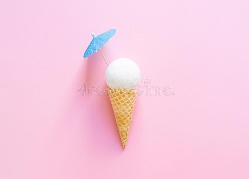 Composition of ice cream cone with white bath ball and beach umbrella stock images