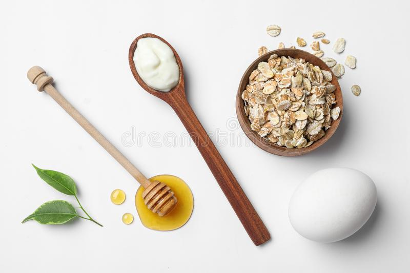 Composition of ingredients for  face mask on white background, top view. Composition of ingredients for handmade face mask on white background, top view stock images