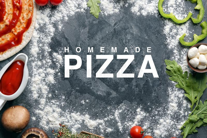 Composition with ingredients for homemade pizza on grey background royalty free stock images