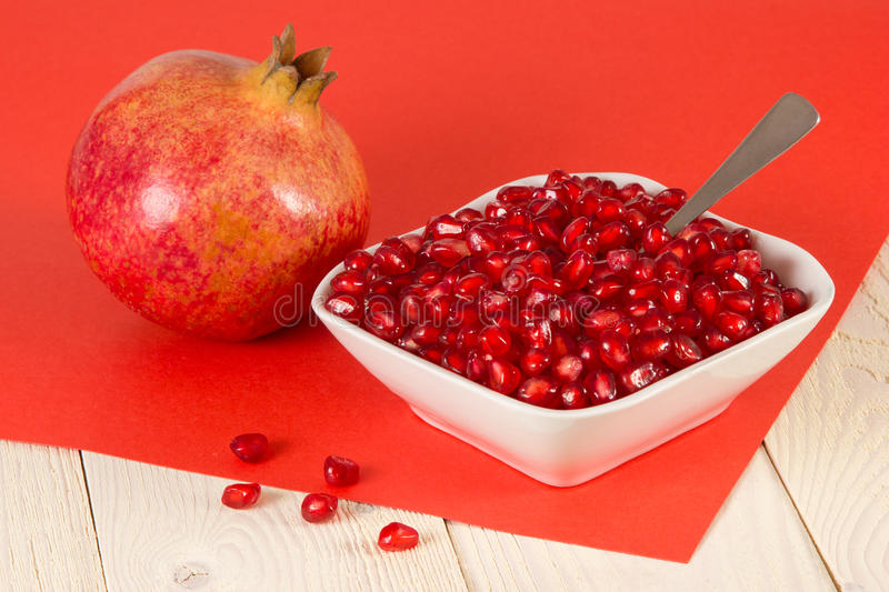 Composition with juicy pomegranate seeds on wooden table stock images