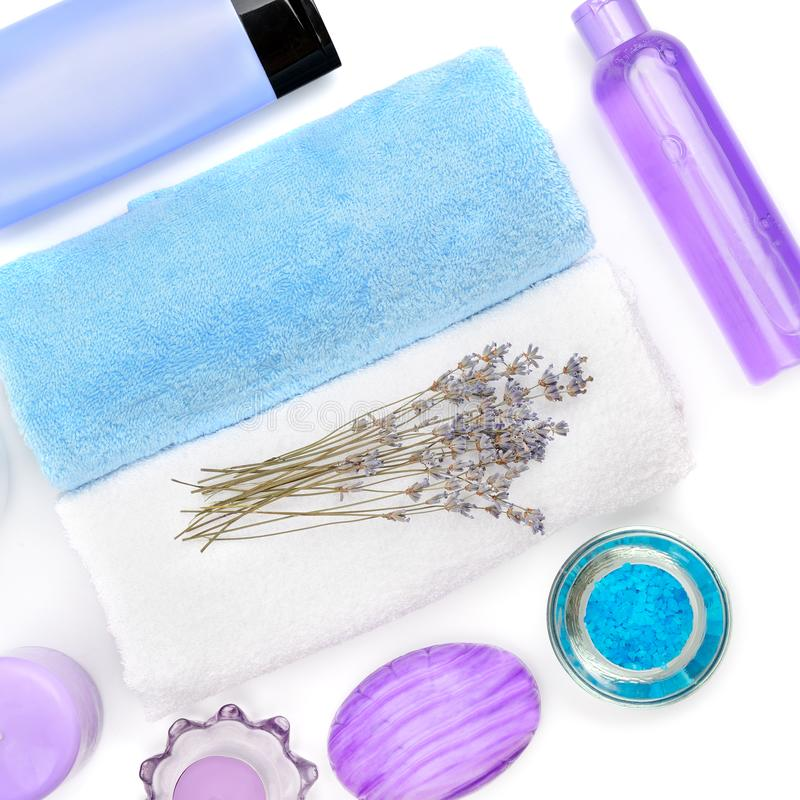Composition with lavender flowers and natural cosmetic isolated on white background. Flat lay,top view stock photography