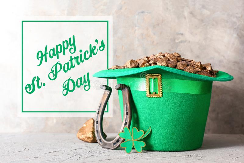 Composition with leprechaun\'s treasure, horseshoe and clover for St. Patrick\'s Day on grey table stock photo